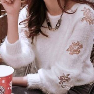 White fluffy sweater with embroidered roses
